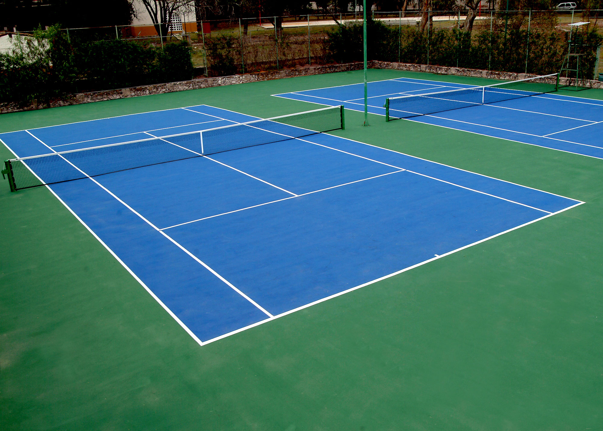 Tennis courts at Hotel Hacienda Jurica by Brisas Queretaro